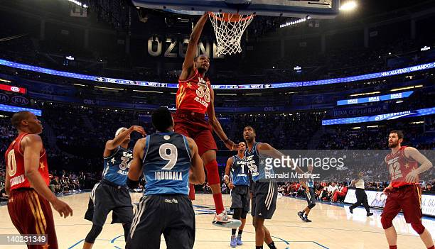 Kevin Durant of the Oklahoma City Thunder and the Western Conference dunks against Andre Iguodala of the Philadelphia 76ers and Roy Hibbert of the...