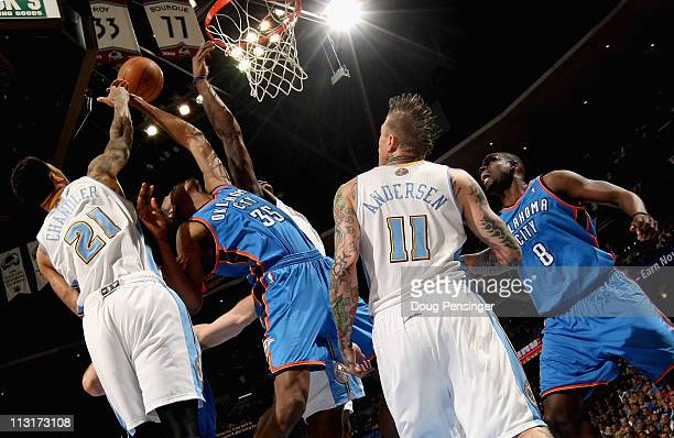 Kevin Durant of the Oklahoma City Thunder and Wilson Chandler of the Denver Nuggets battle for a rebound as Chris Andersen of the Denver Nuggets and...
