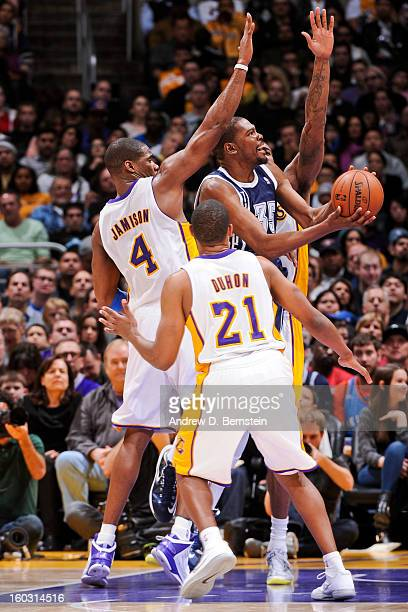 Kevin Durant of the Oklahoma City Thunder attempts a shot against Chris Duhon and Antawn Jamison of the Los Angeles Lakers at Staples Center on...
