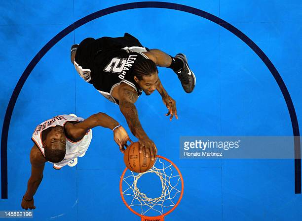Kevin Durant of the Oklahoma City Thunder blocks the dunk of Kawhi Leonard of the San Antonio Spurs in Game Six of the Western Conference Finals of...