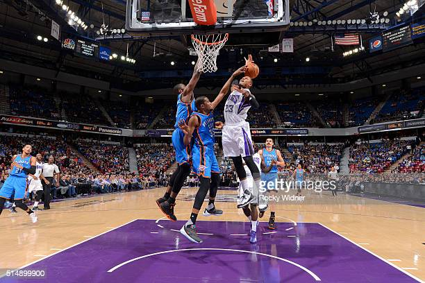 Kevin Durant of the Oklahoma City Thunder blocks the shot of Ben McLemore of the Sacramento Kings on February 29 2016 at Sleep Train Arena in...