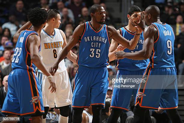 Kevin Durant of the Oklahoma City Thunder celebrates a play against Danilo Gallinari and the Denver Nuggets with teammates Cameron Payne Serge Ibaka...