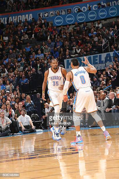 Kevin Durant of the Oklahoma City Thunder celebrates with Russell Westbrook of the Oklahoma City Thunder during the game against the Orlando Magic on...