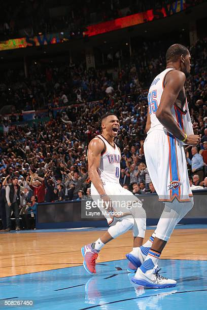 Kevin Durant of the Oklahoma City Thunder celebrates with Russell Westbrook of the Oklahoma City Thunder after hitting the game winning shot against...