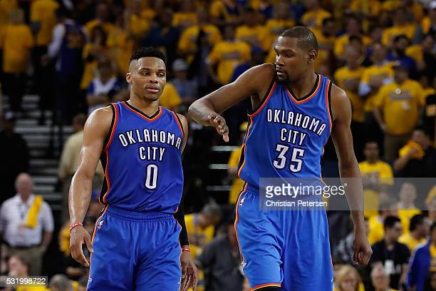 Kevin Durant of the Oklahoma City Thunder celebrates with Russell Westbrook during the final moments of game one of the NBA Western Conference Finals...
