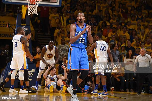Kevin Durant of the Oklahoma City Thunder claps after a play against the Golden State Warriors during Game Seven of the Western Conference Finals...
