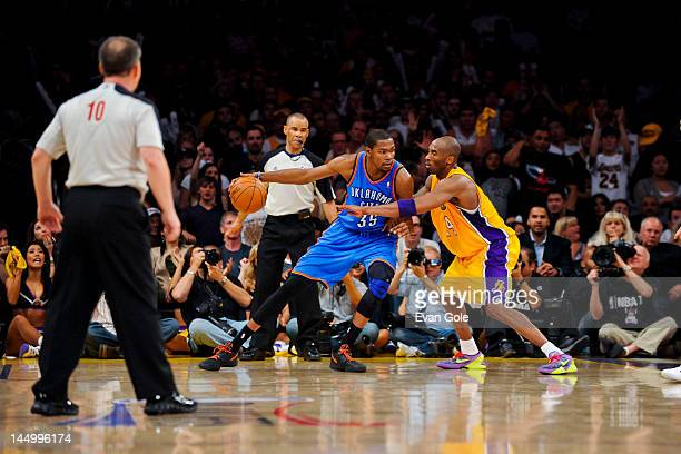03aca463f1ea Kevin Durant of the Oklahoma City Thunder controls the ball against Kobe  Bryant of the Los