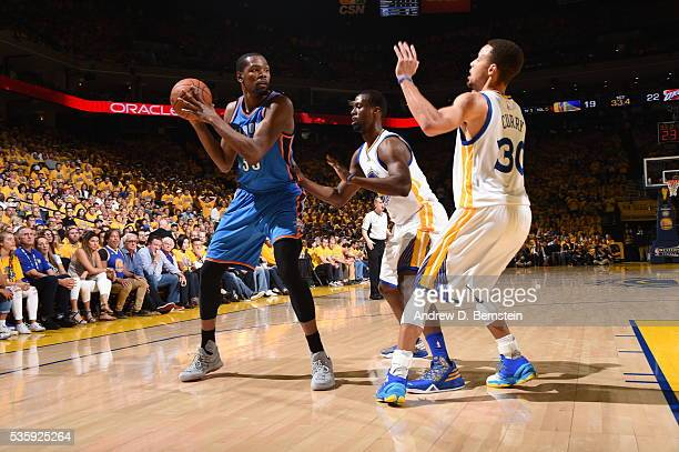 Kevin Durant of the Oklahoma City Thunder defends the ball against the Golden State Warriors during Game Seven of the Western Conference Finals...