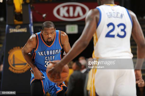 Kevin Durant of the Oklahoma City Thunder defends the basket against Draymond Green of the Golden State Warriors during Game Five of the Western...