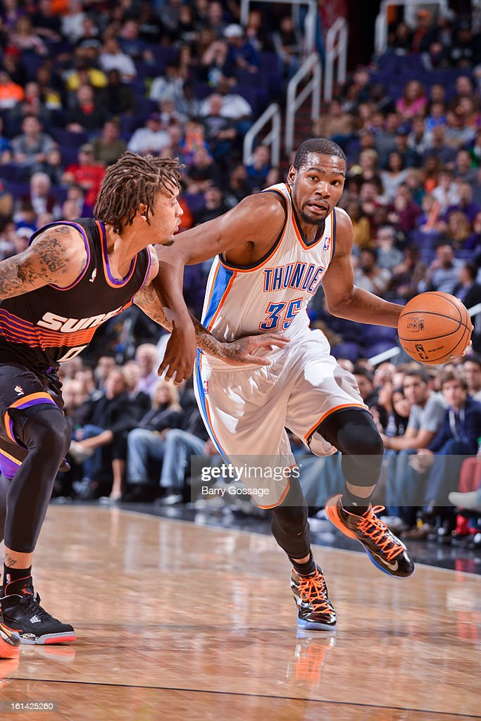 Kevin Durant #35 of the Oklahoma City Thunder drives against Michael Beasley #0 of the Phoenix Suns on February 10, 2013 at U.S. Airways Center in Phoenix, Arizona.