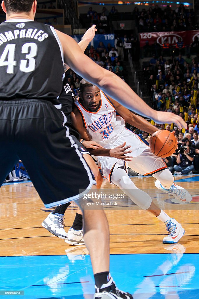 Kevin Durant #35 of the Oklahoma City Thunder drives against the Brooklyn Nets on January 2, 2013 at the Chesapeake Energy Arena in Oklahoma City, Oklahoma.
