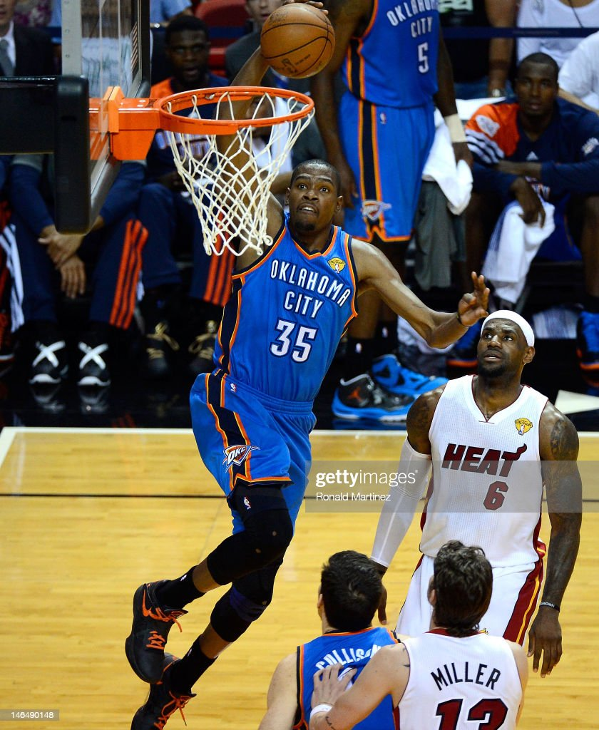 Kevin Durant #35 of the Oklahoma City Thunder drives for a dunk attempt in the first half against LeBron James #6 of the Miami Heat in Game Three of the 2012 NBA Finals on June 17, 2012 at American Airlines Arena in Miami, Florida.