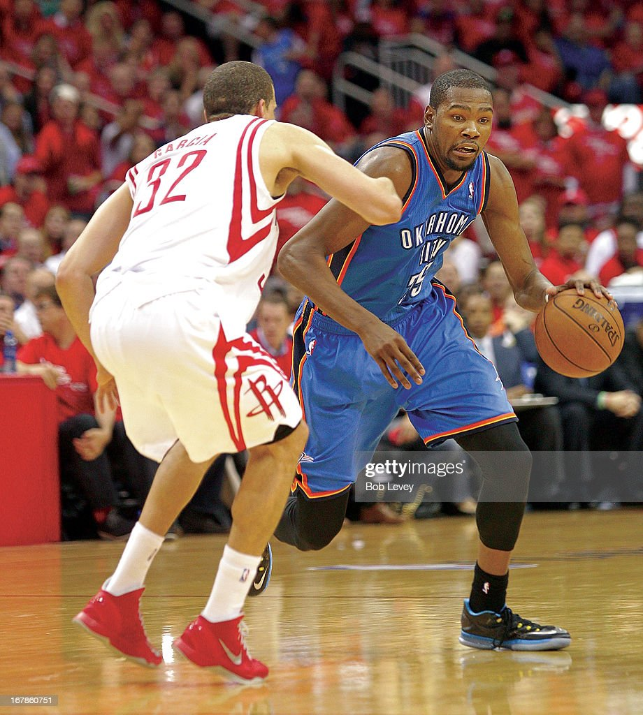 c5a019bde4b0 Kevin Durant of the Oklahoma City Thunder drives on Francisco Garcia ...
