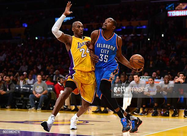 Kevin Durant of the Oklahoma City Thunder drives on Kobe Bryant of the Los Angeles Lakers during the first half at Staples Center on December 23 2015...