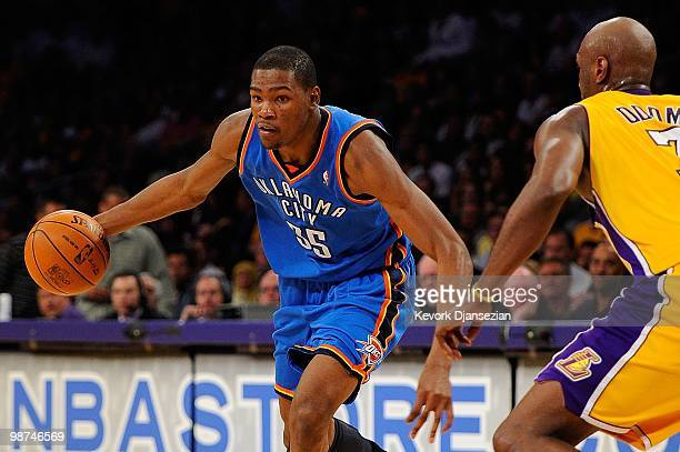 Kevin Durant of the Oklahoma City Thunder drives on Lamar Odom of the Los Angeles Lakers during Game Five of the Western Conference Quarterfinals of...
