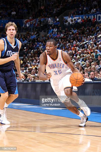 Kevin Durant of the Oklahoma City Thunder drives past Dirk Nowitzki of the Dallas Mavericks during an NBA game on December 29 2011 at the Chesapeake...