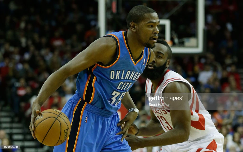 7547362d5b47 Kevin Durant of the Oklahoma City Thunder drives past James Harden ...