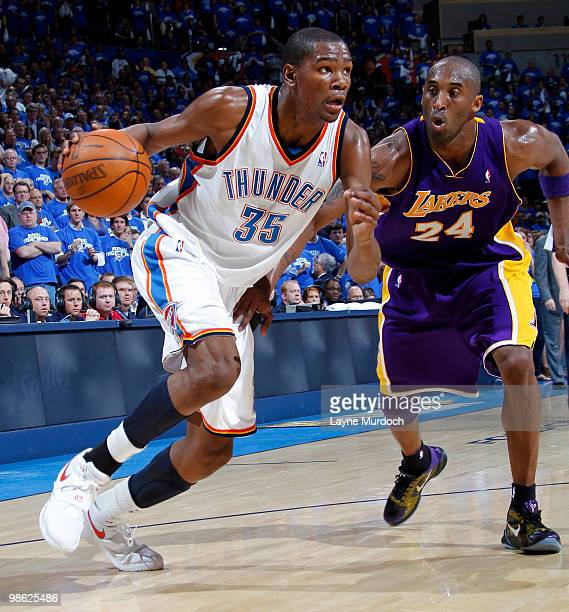 Kevin Durant of the Oklahoma City Thunder drives to the basket against Kobe Bryant of the Los Angeles Lakers in Game Three of the Western Conference...