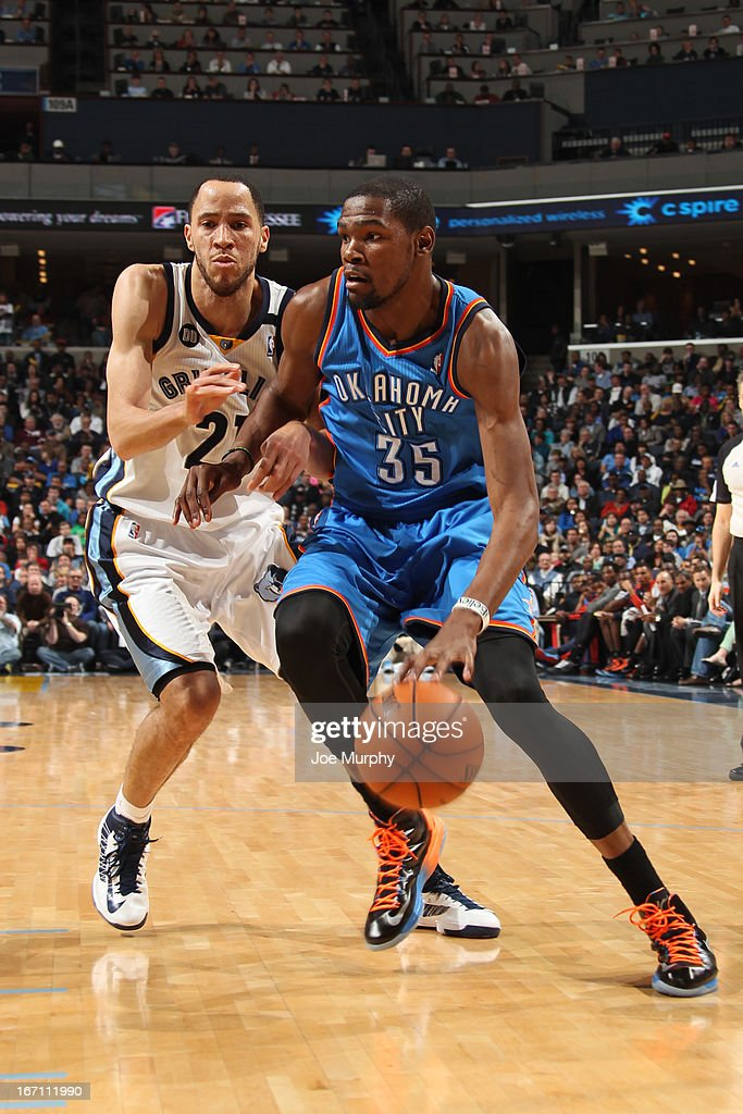 Kevin Durant #35 of the Oklahoma City Thunder drives to the basket against Tayshaun Prince #21 of the Memphis Grizzlies on March 20, 2013 at FedExForum in Memphis, Tennessee.