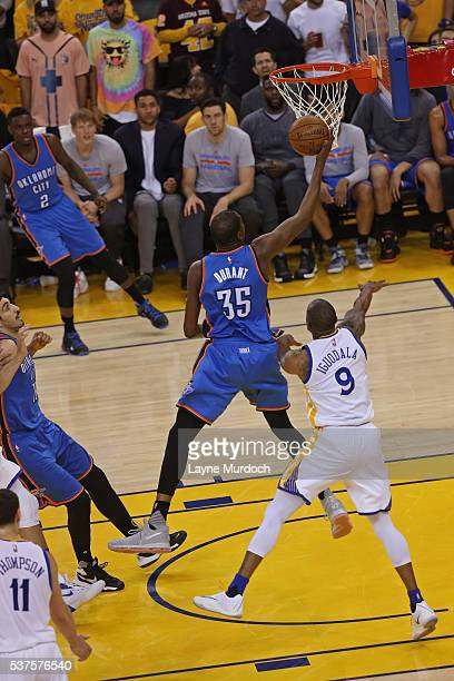 Kevin Durant of the Oklahoma City Thunder drives to the basket against the Golden State Warriors in Game Five of the Western Conference Finals during...