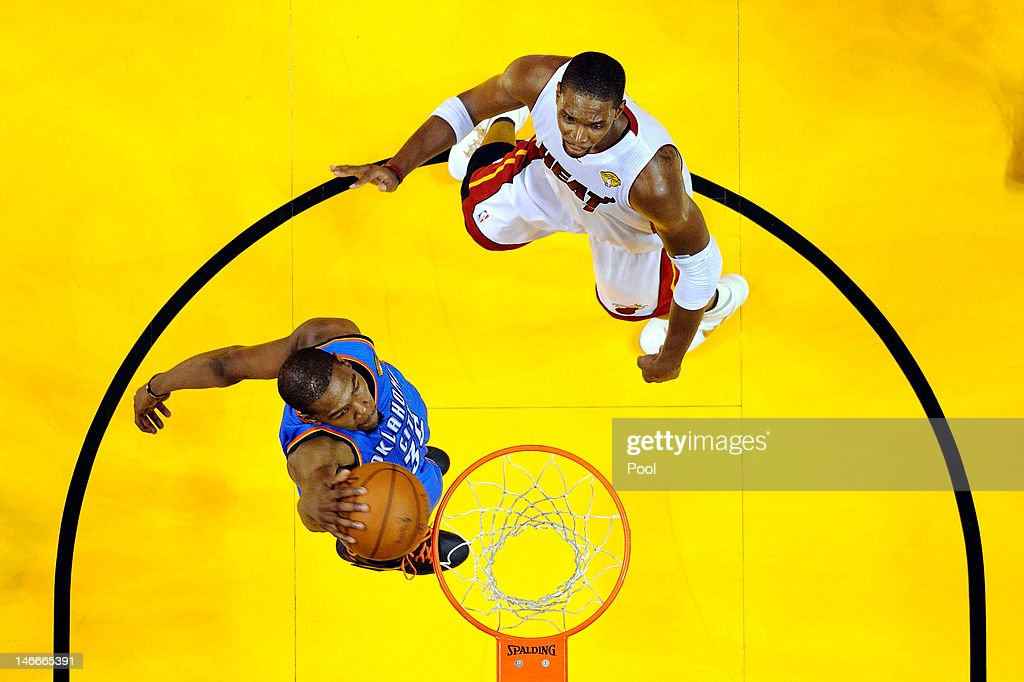 Kevin Durant #35 of the Oklahoma City Thunder dunks against Chris Bosh #1 of the Miami Heat in Game Five of the 2012 NBA Finals on June 21, 2012 at American Airlines Arena in Miami, Florida.