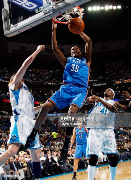 Kevin Durant of the Oklahoma City Thunder dunks against Darius Songaila and James Posey of the New Orleans Hornets on February 3 2010 at the New...