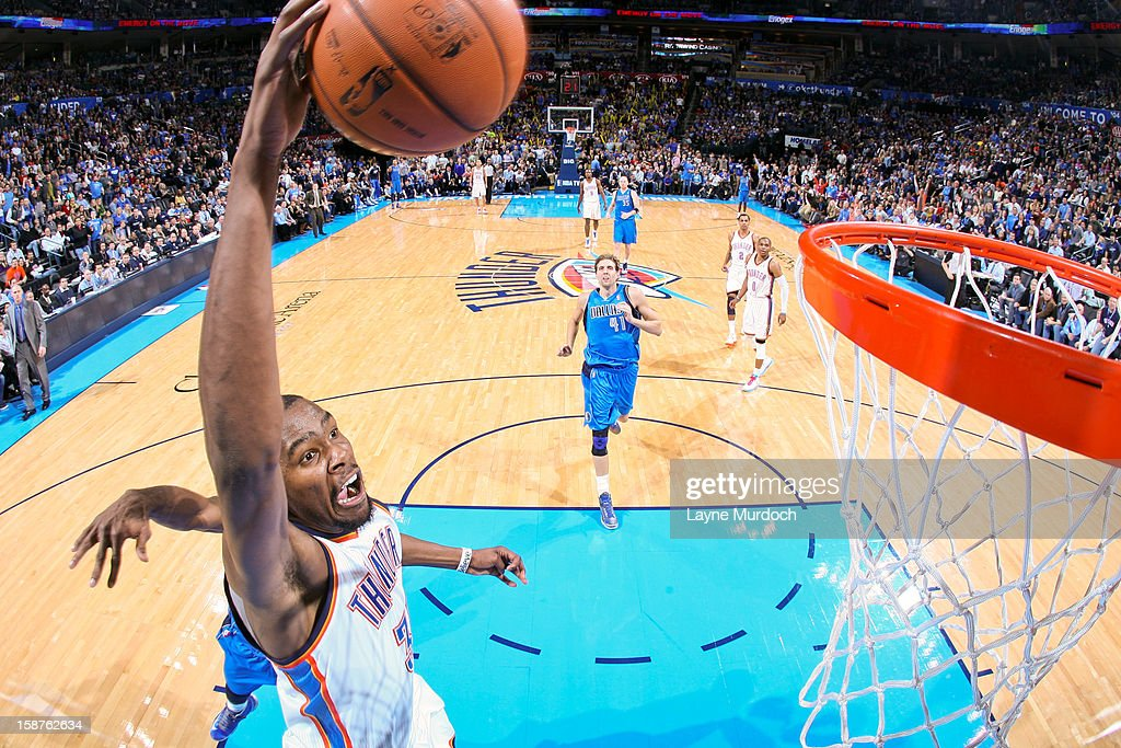 Kevin Durant #35 of the Oklahoma City Thunder dunks against the Dallas Mavericks on December 27, 2012 at the Chesapeake Energy Arena in Oklahoma City, Oklahoma.