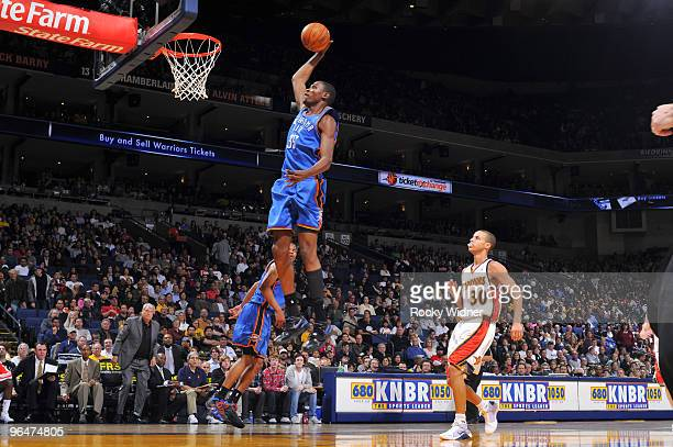 Kevin Durant of the Oklahoma City Thunder dunks against the Golden State Warriors on February 6 2010 at Oracle Arena in Oakland California NOTE TO...
