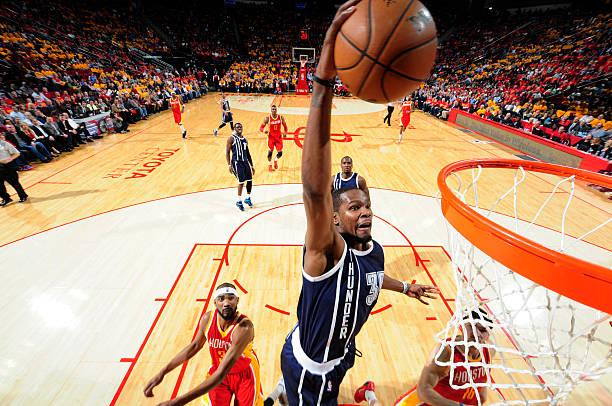 5ce667cff615 Oklahoma City Thunder v Houston Rockets. Bill Baptist. Kevin Durant of the Oklahoma  City Thunder dunks against... Photo ID 461595938