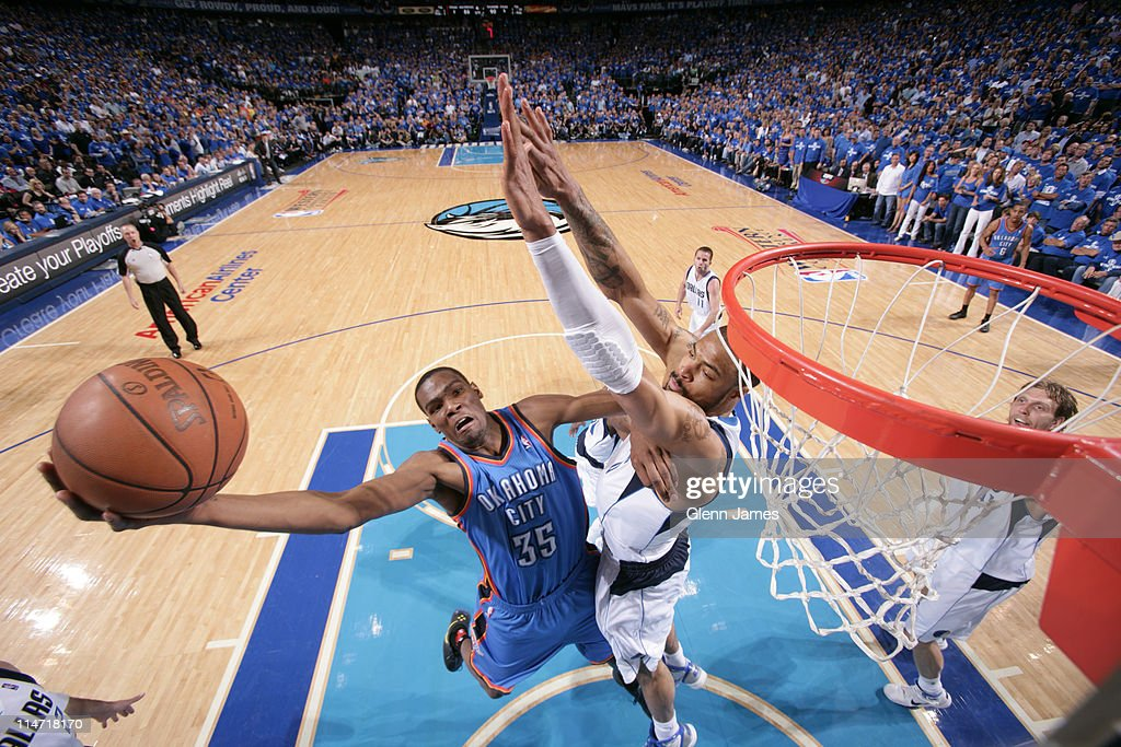 Kevin Durant #35 of the Oklahoma City Thunder dunks against Tyson Chandler #6 of the Dallas Mavericks during Game Five of the Western Conference Finals in the 2011 NBA Playoffs on May 25, 2011 at the American Airlines Center in Dallas, Texas.