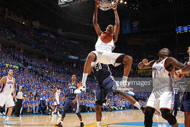 Kevin Durant of the Oklahoma City Thunder dunks against Zach Randolph of the Memphis Grizzlies during Game Seven of the Western Conference Semifinals...