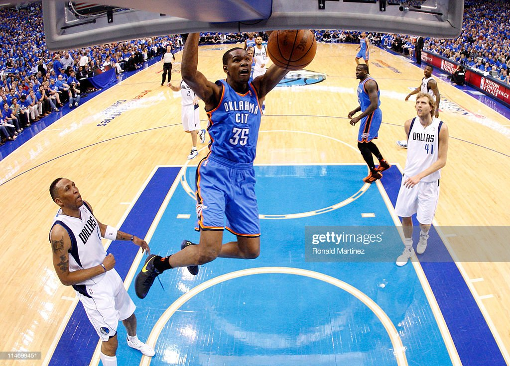 Kevin Durant #35 of the Oklahoma City Thunder dunks the ball in the first half while taking on the Dallas Mavericks in Game Five of the Western Conference Finals during the 2011 NBA Playoffs at American Airlines Center on May 25, 2011 in Dallas, Texas.