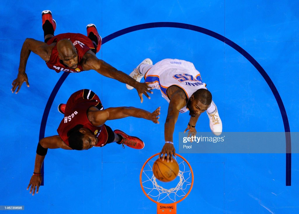 Kevin Durant #35 of the Oklahoma City Thunder dunks the ball over Joel Anthony #50 and Chris Bosh #1 of the Miami Heat in the second quarter in Game One of the 2012 NBA Finals at Chesapeake Energy Arena on June 12, 2012 in Oklahoma City, Oklahoma.