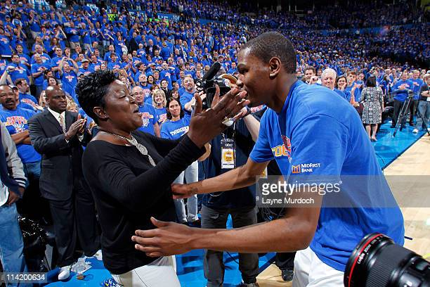 Kevin Durant of the Oklahoma City Thunder embraces his mother Wanda Pratt after defeating the Memphis Grizzlies in Game Seven of the Western...