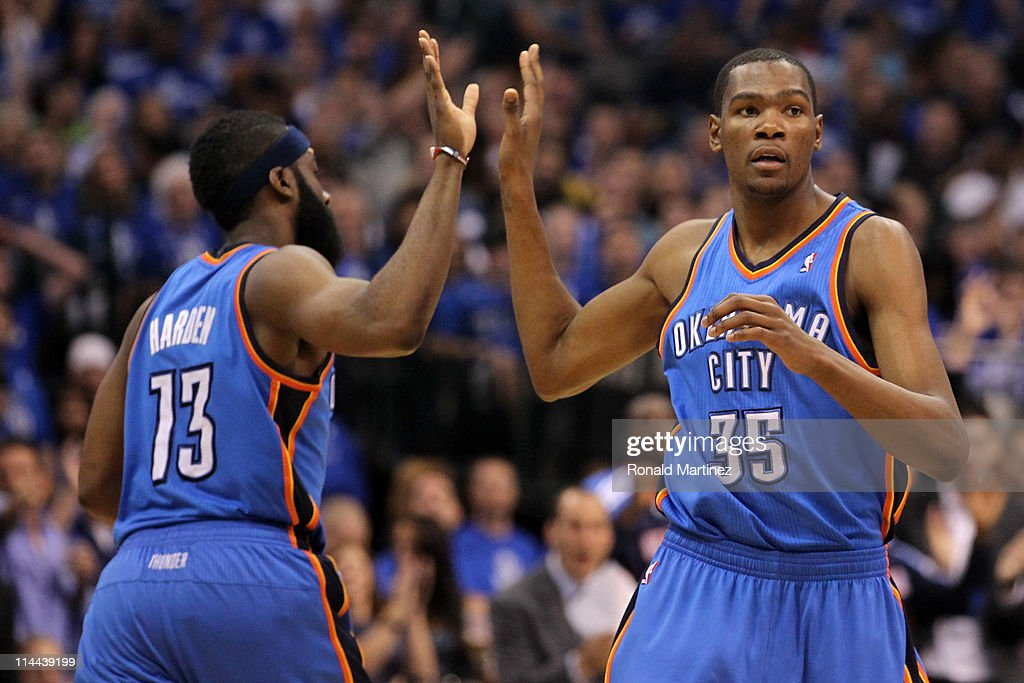 Kevin Durant #35 of the Oklahoma City Thunder gives a five to teammate James Harden #13 in the second half while taking on the Dallas Mavericks in Game Two of the Western Conference Finals during the 2011 NBA Playoffs at American Airlines Center on May 19, 2011 in Dallas, Texas.