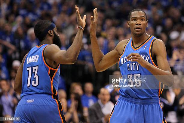 Kevin Durant of the Oklahoma City Thunder gives a five to teammate James Harden in the second half while taking on the Dallas Mavericks in Game Two...