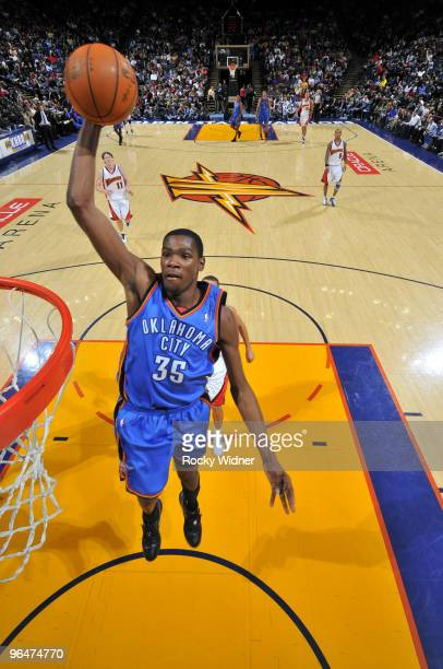 Kevin Durant of the Oklahoma City Thunder goes in for the dunk against the Golden State Warriors on February 6 2010 at Oracle Arena in Oakland...