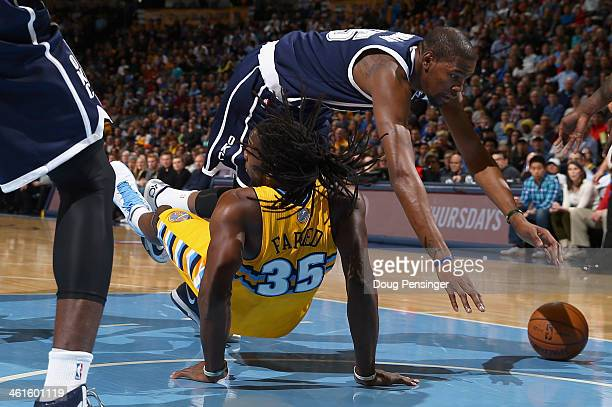 Kevin Durant of the Oklahoma City Thunder goes the court after being fouled by Kenneth Faried of the Denver Nuggets at Pepsi Center on January 9 2014...