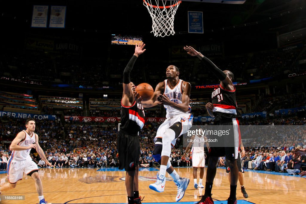 Kevin Durant #35 of the Oklahoma City Thunder goes to the basket against J.J. Hickson #21 and LaMarcus Aldridge #12 of the Portland Trail Blazers on November 2, 2012 at the Chesapeake Energy Arena in Oklahoma City, Oklahoma.