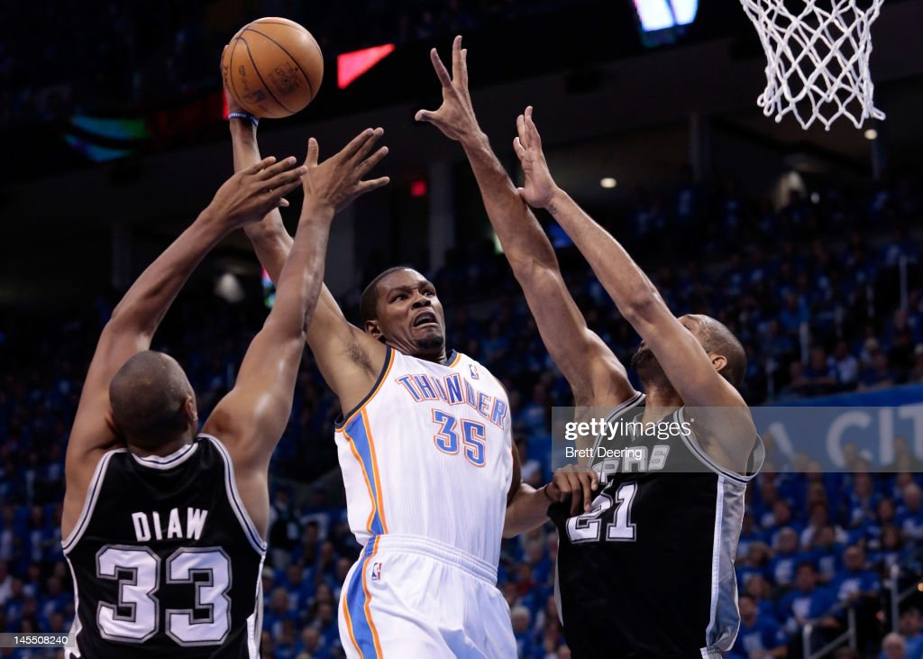 Kevin Durant #35 of the Oklahoma City Thunder goes up for a dunk between Boris Diaw #33 and Tim Duncan #21 of the San Antonio Spurs in the second quarter in Game Three of the Western Conference Finals of the 2012 NBA Playoffs at Chesapeake Energy Arena on May 31, 2012 in Oklahoma City, Oklahoma.