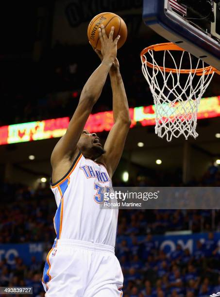 Kevin Durant of the Oklahoma City Thunder goes up for a dunk in the third quarter against the San Antonio Spurs during Game Three of the Western...