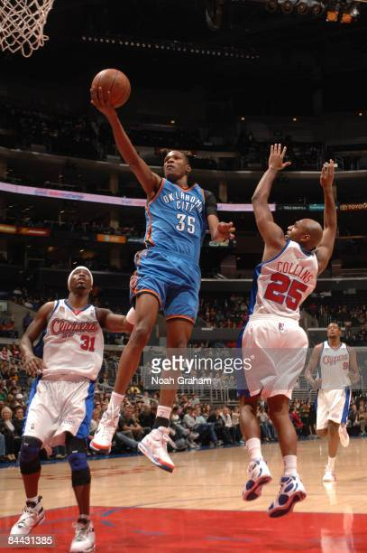 Kevin Durant of the Oklahoma City Thunder goes up for a layup between Ricky Davis and Mardy Collins of the Los Angeles Clippers at Staples Center on...
