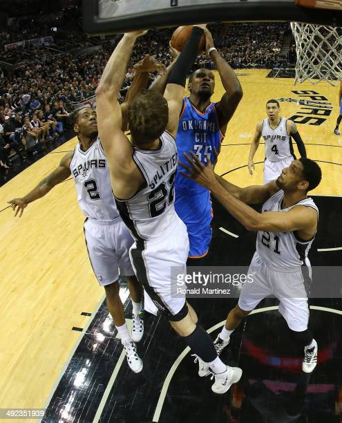 Kevin Durant of the Oklahoma City Thunder goes up for a shot against Kawhi Leonard Tiago Splitter and Tim Duncan of the San Antonio Spurs in the...