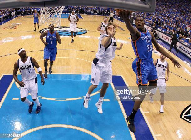 Kevin Durant of the Oklahoma City Thunder goes up for a shot in front of Dirk Nowitzki of the Dallas Mavericks in the first half in Game One of the...