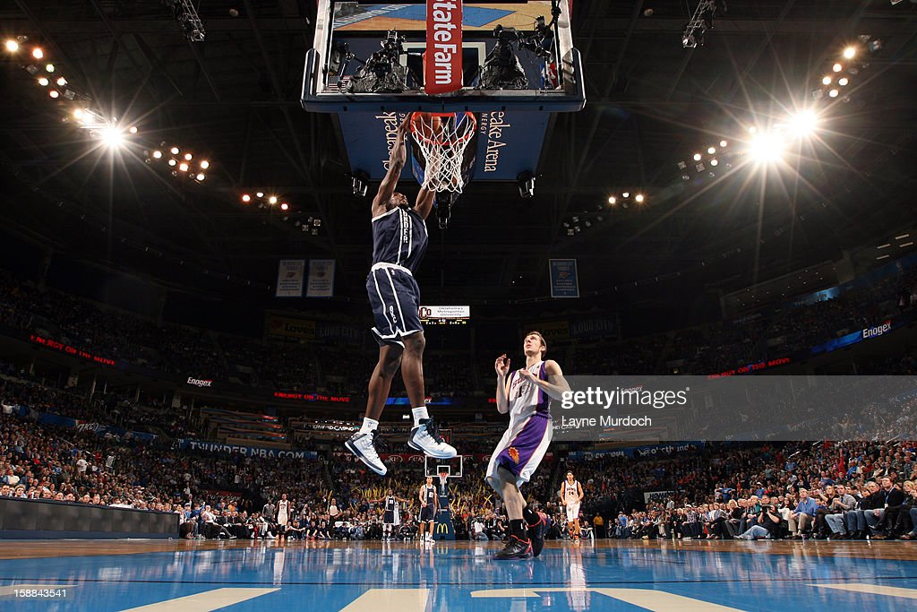 Kevin Durant #35 of the Oklahoma City Thunder goes up for the dunk against the Phoenix Suns during an NBA game on December 31, 2012 at the Chesapeake Energy Arena in Oklahoma City, Oklahoma.