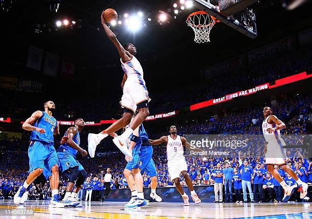 Kevin Durant of the Oklahoma City Thunder goes up to dunk the ball in the first quarter against the Dallas Mavericks in Game Four of the Western...
