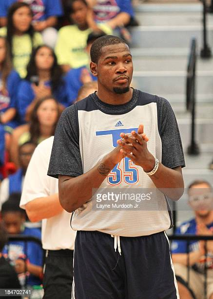 Kevin Durant of the Oklahoma City Thunder greets fans after practice on October 13 2013 at West Moore High School in Moore Oklahoma to meet with fans...