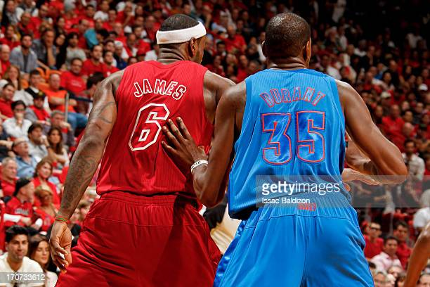 Kevin Durant of the Oklahoma City Thunder guards LeBron James of the Miami Heat during a Christmas Day game on December 25 2012 at American Airlines...