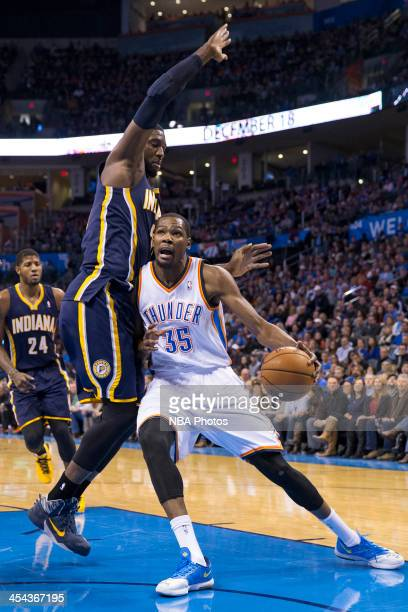 Kevin Durant of the Oklahoma City Thunder handles the ball against Roy Hibbert of the Indiana Pacers at the Chesapeake Energy Arena on December 8...