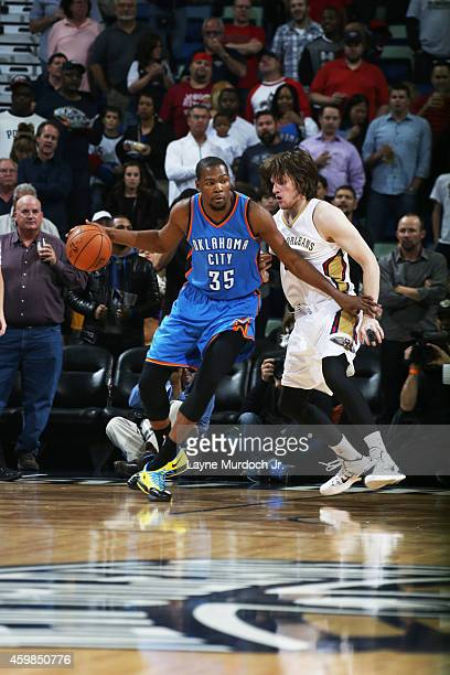 Kevin Durant of the Oklahoma City Thunder handles the ball against the New Orleans Pelicans during the game on December 2 2014 at the Smoothie King...